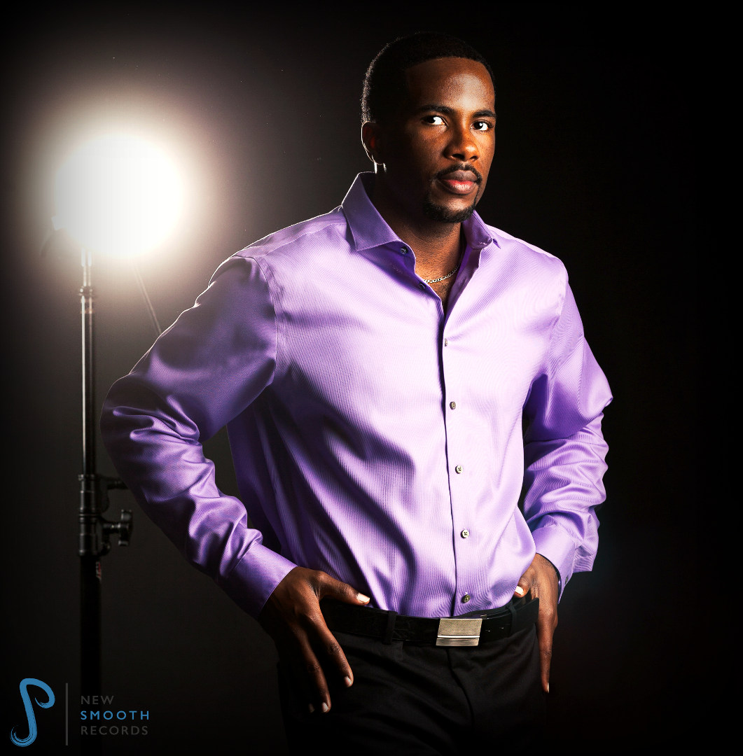 Dressed in a purple colored shirt, the spotlight is on AJ Smooth