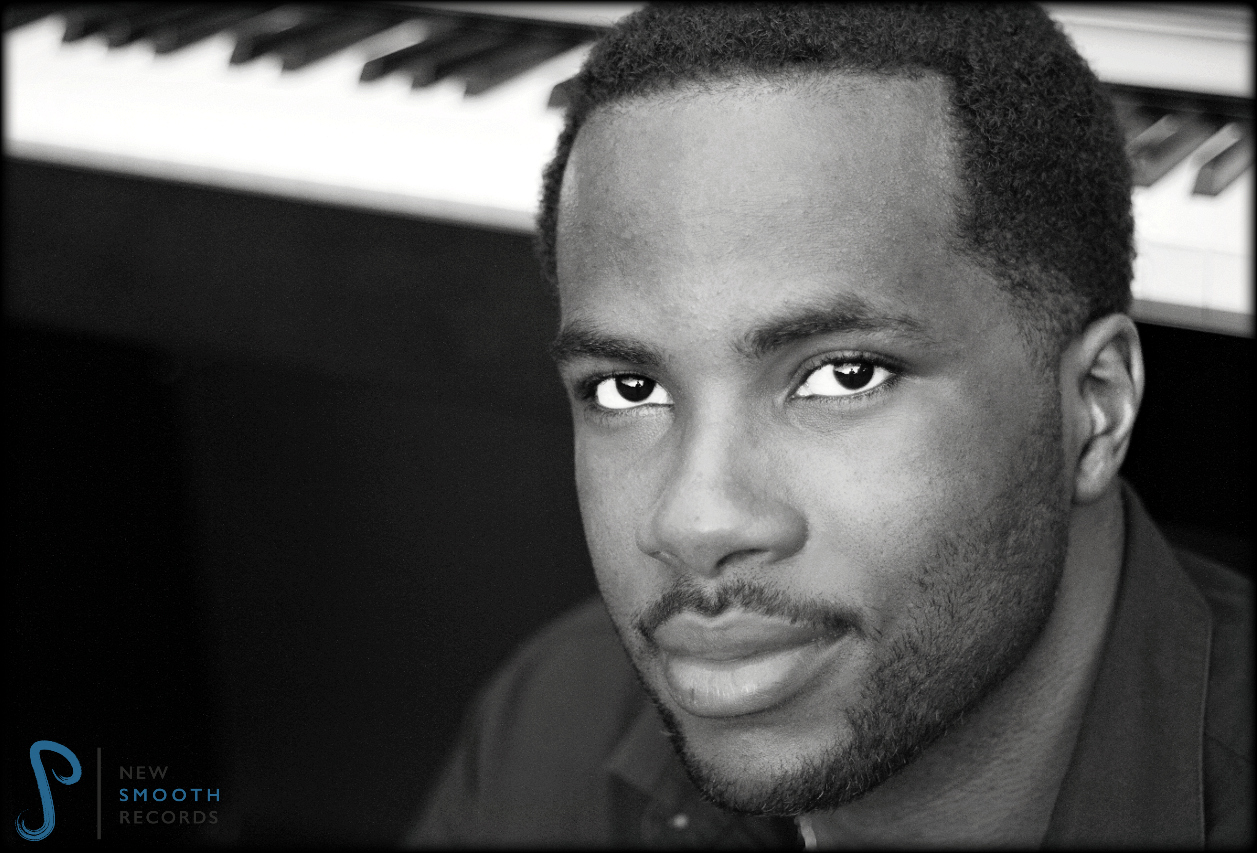 With his piano in the background, singer AJ Smooth sits calmly in front
